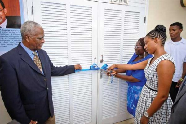 Former LUCELEC Managing Director Bernard Theobalds, Mrs Clydella Huggins and her daughter cut the ribbon to officially open the LUCELEC workshop named in honour of Mr. Theobalds and Mr. Huggins.