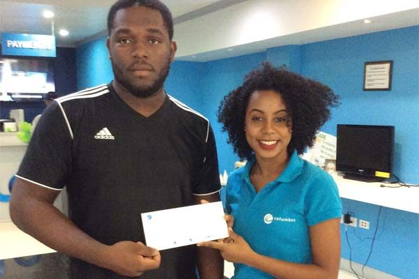 Image: Bishamber receives his cheque from Flows BibiannaMangal. Below is Lance Mathurin.
