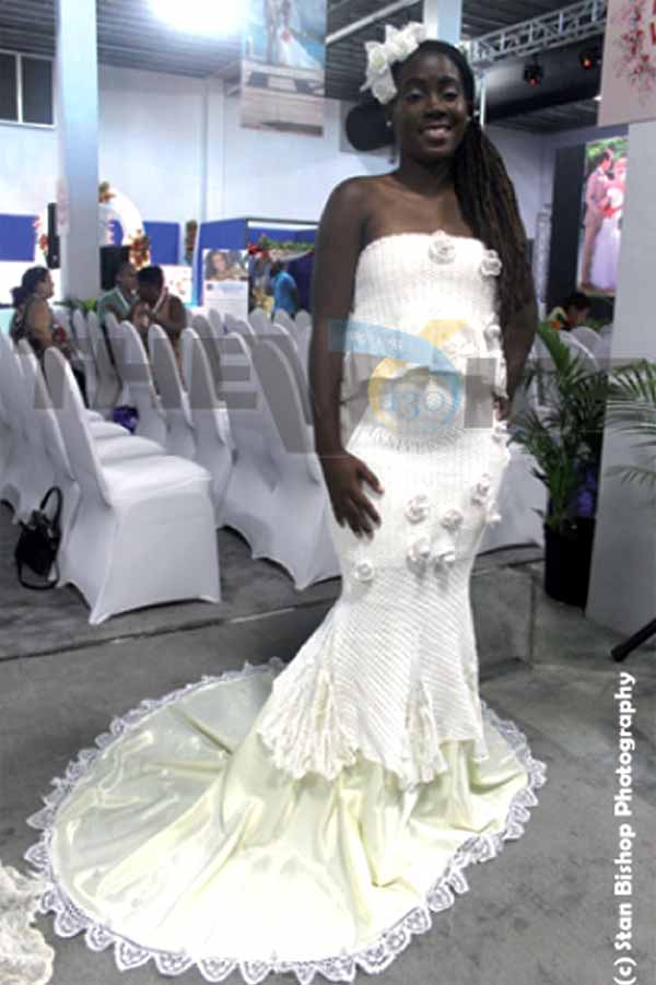 A model displaying a crochet wedding dress made by Marcella St. Omer. [PHOTO: Stan Bishop]