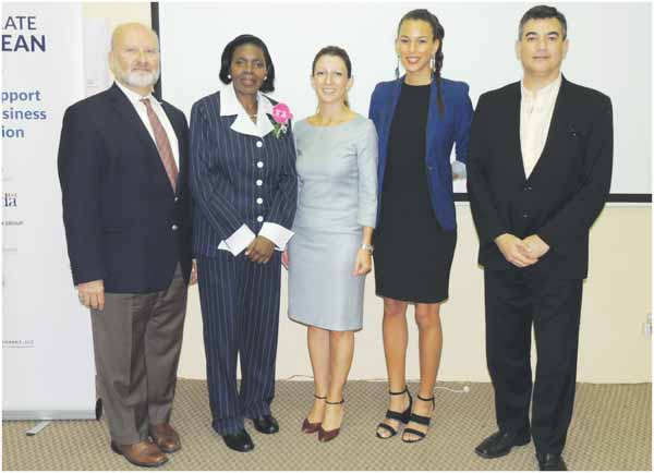 Minister Hippolyte with IMC team.