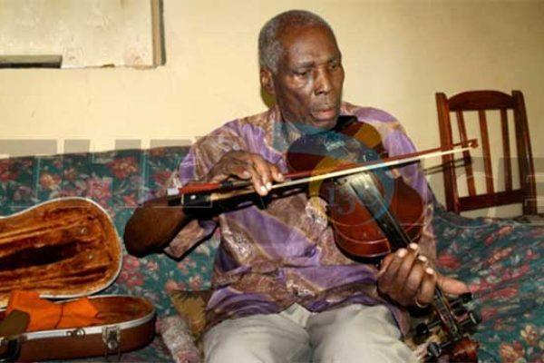 "Violinist and Saint Lucian icon, Joseph ""Rameau"" Poleon. [PHOTO: Stan Bishop]"