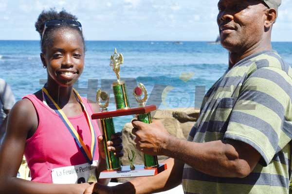 ThomykaValcent receiving her 1st place trophy from Pastor Lennox Maxius. (Photo Anthony De Beauville)