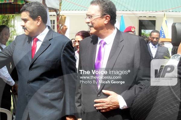 Image of the two leaders walking down the path that leads from the main area of the official residence to the gazebo on the residence grounds to meet NICE workers and the musical band.