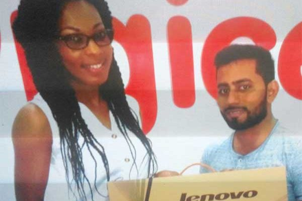 Ahmad collects from Digicel's Louise Victor.