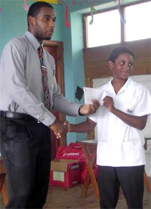 Image: August gets a grant from Scotiabank's Augustinus Andrew