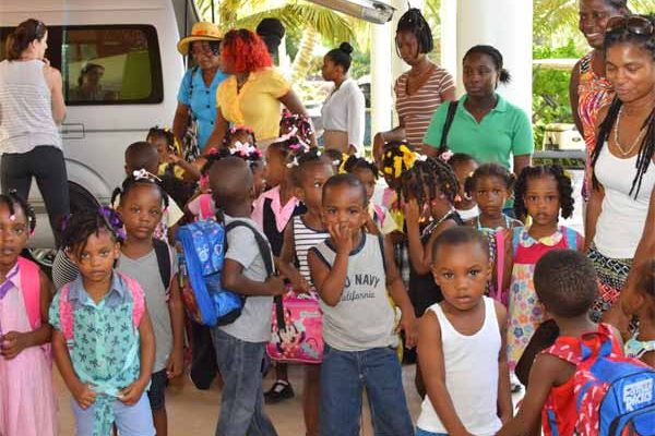 Image: Children from the south being entertained at Coconut Bay.