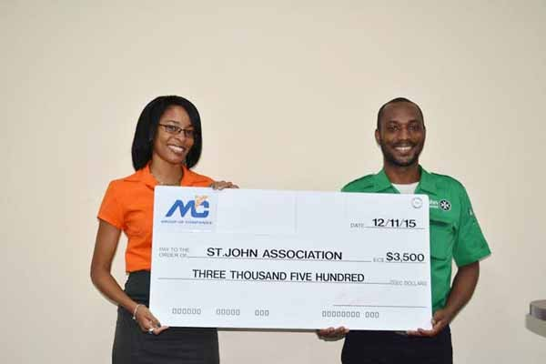 In photo from left to right: Ms Fern Wilson, Marketing Coordinator, M&C Group of Companies presenting a cheque to Mr Glen Wilson of St. John Saint Lucia.