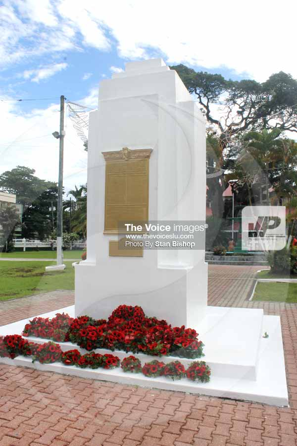 Image: Red wreaths laid at the base of the War Memorial in Derek Walcott Square.
