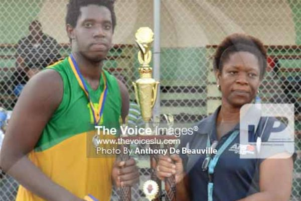 (L-R) SALCC captain No. 15 Jaryl Bernard receiving the championship trophy from school Youth and Sports Officer/Coordinator Isabel Marquis. (PHOTO: Anthony De Beauville)