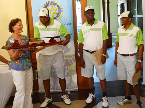 Image: Susan Guillaume presenting the Claude Guillaume Memorial trophy to Team Sandals La Toc