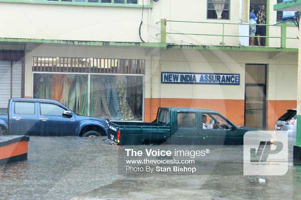 Image: Vehicles wading through the flooded streets of Castries yesterday. [PHOTO: Stan Bishop]