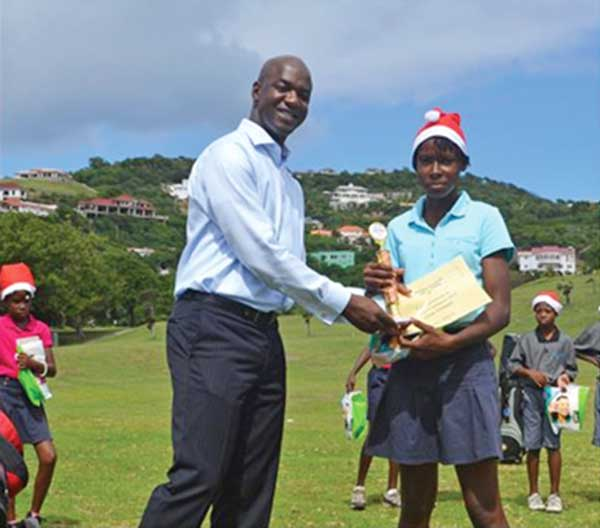 Lisa Daniel, Girls Champion, with The Landings General Manager Wilbert Mason