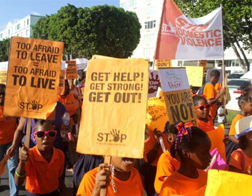 Image: Marchers along the Castries Waterfront last Wednesday afternoon. [PHOTO: Stan Bishop]