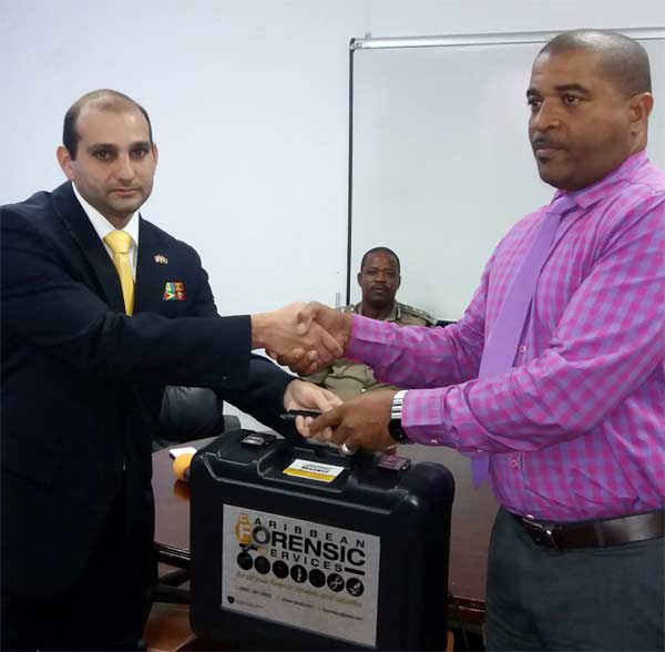 Image: Aboud presents the forensic kit.
