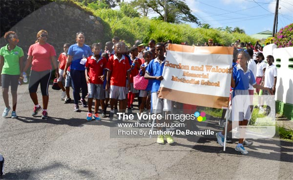 Image: Students from Gordon and Walcott Memorial making their way back to Camille Henry SchooL.(PHOTO: Anthony De Beauville)