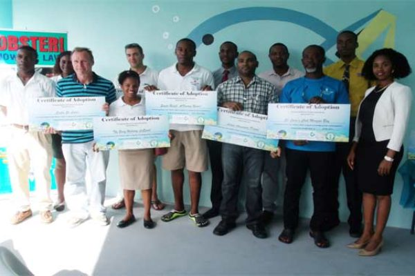 "Image: Six dive shops affiliated with hotel properties in Saint Lucia received an ""Adopt a Reef"" certificate in recognition of their willingness to be trained to support reef monitoring activity along the island's coast."