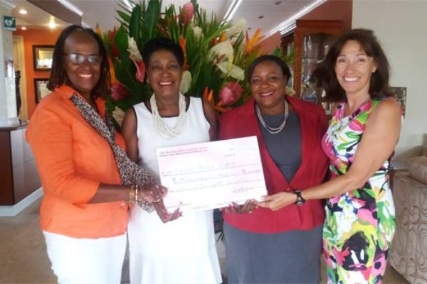"""Catherine Sealys (second from right) is presented with a $10,400 cheque from """"100 Women who Care"""""""