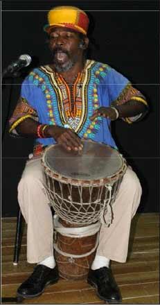 "Drummer Joseph ""Jean"" John during a recent performance.  [PHOTO: Stan Bishop]"