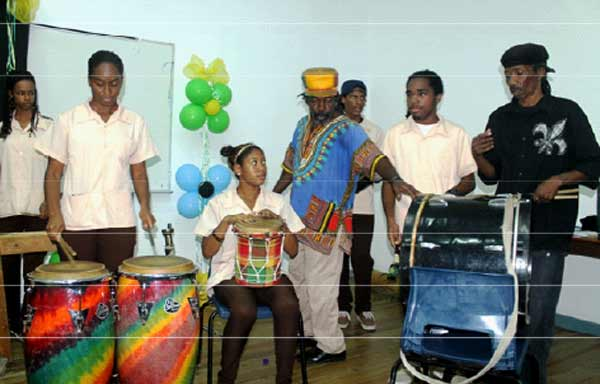"""John teaming up with fellow drummer, Niger Nestor, at this year's SALCC """"Meet The Artiste"""" where they gave students basic tips on drumming.  [PHOTO: Stan Bishop]"""