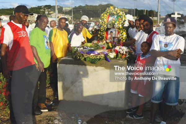 Image: Members of the Congorians football team say their final goodbye. (Photo Anthony De Beauville)