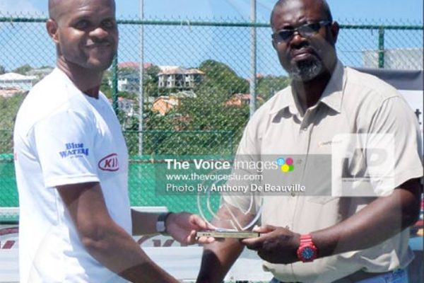 (L-R) Men's Open Champion AkeemGustave receiving his champions trophy from a KIA Motors representative. (PHOTO: Anthony De Beauville))