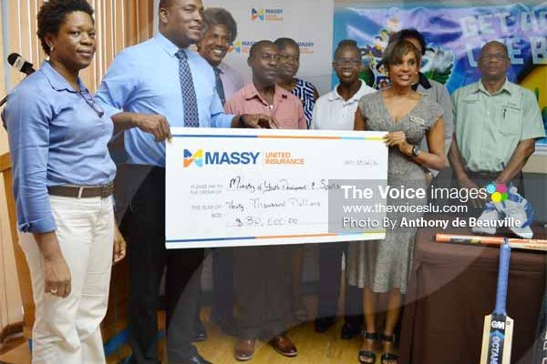 Minister for Youth Development and Sports receiving a $30,000.00 sponsorship cheque from Massy United General Manager Faye Miller, while members of staff from the Ministry, Massy United and SLNCA look on. [PHOTO: Anthony de Beauville]
