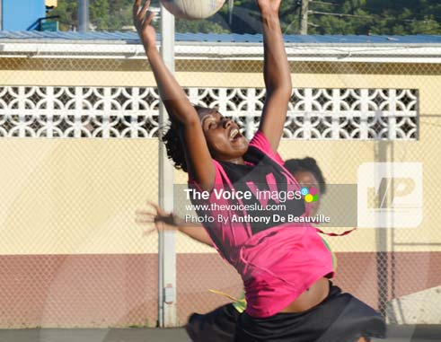 Image: N.V. Ballers (Wing Attack) Melody Charles goes for a high pass overhead against Shamrock (Photo Anthony De Beauville)