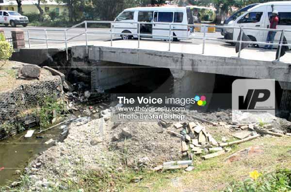 Image: A huge pile of debris left under the recently-renovated bridge at Rodney Bay. [PHOTO: Stan Bishop]