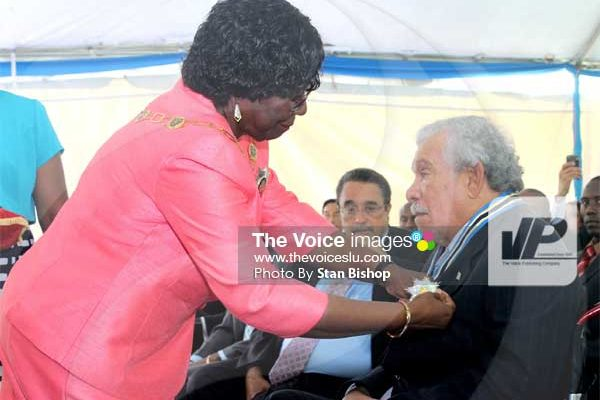 Poet Derek Walcott receiving his knighthood from Dame PearletteLouisy. PHOTO BY: Stan Bishop
