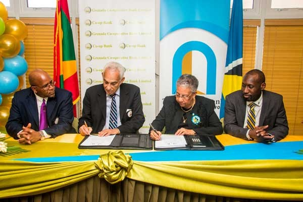 Image: Dr. Gardner (second from right) and Andy Delmar (right), Managing Director of 1st National at the signing.