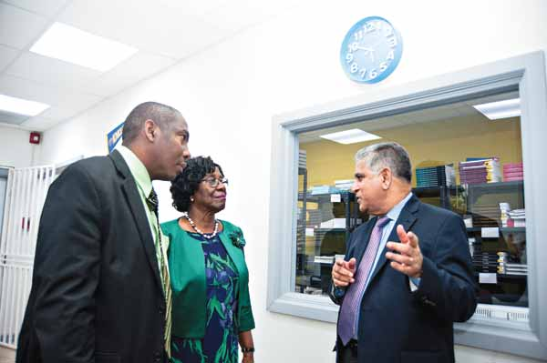 Image: Senior Vice President, Dr. Alex Ephrem gives Governor-General and Minister of Education tour of Learning Resources Centre . (Photo:: Bill Mortley)