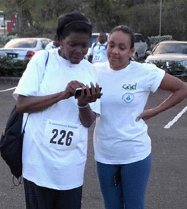 Image: The Minister Emma Hippolyte and the Permanent Secretary AllisionGagadhar (at left and right respectively) in discussion before the walk started.
