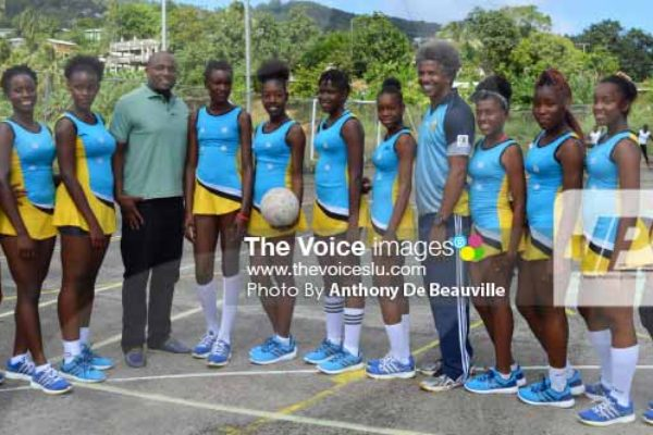 Image: A photo moment for Team St. Lucia on Saturday with Minister of Youth Development and Sports and Acting PS Dr. Anthony George. [PHOTO: Anthony De Beauville]