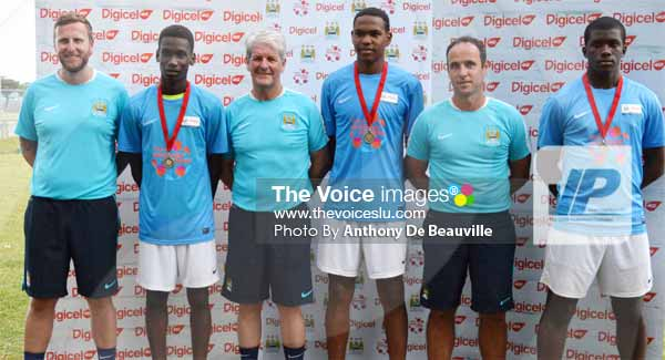 Image: A proud moment for the top three players Nyron Winter, JevelTobierre and Mario Lendor as their stand alongside the Manchester City FC coaches. (PHOTO: Anthony De Beauville)