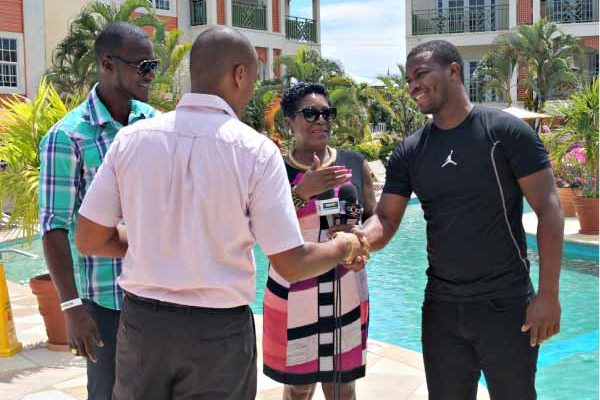 Image: Bay Gardens officials greet Sammy and Charles