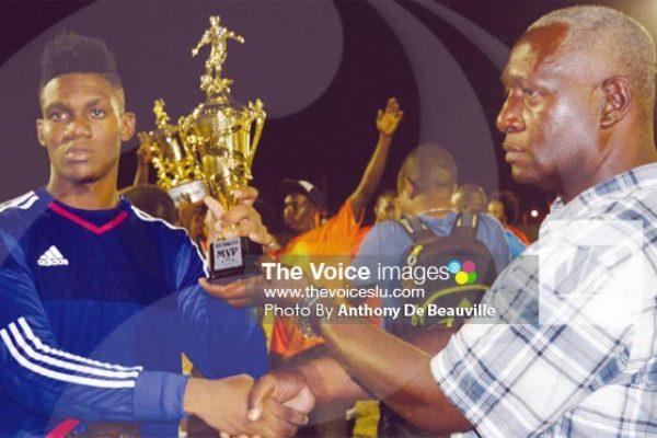 Image: Micoud 2 custodian Noah Didier receiving the MVP from SLFA representative Emmanuel Belasse. (PHOTO: Anthony De Beauville)