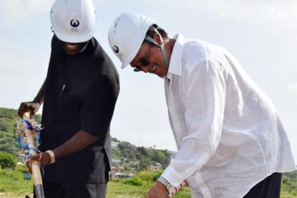 PM Anthony and NIC Director Matthew Mathurin break the ground to start construction