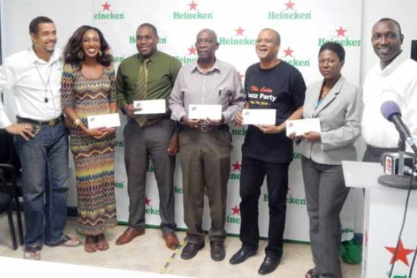 Image: Representatives of the various group organizing Jazz events were on hand to receive their sponsorship cheques from Heineken. Left to right are: Thomas Leonce, Sales & Marketing Manager WLBL, Candy Nicholas of Soufriere Jazz, Louis Lewis, Director of SLTB, Gus Small of Different Shades, Peter St. Rose of Salsa Saint Lucia, Lydia d'Auvergne of HTS/Jazz on the Square and Gaius Harry, Heineken Brand Manager.