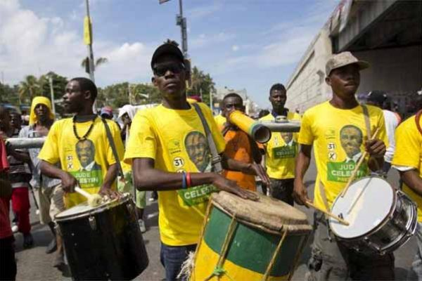 Image: Supporters of presidential candidate Jude Celestin from the LAPEH political party, play the drums during campaign rally in Port-au-Prince, Haiti last October.