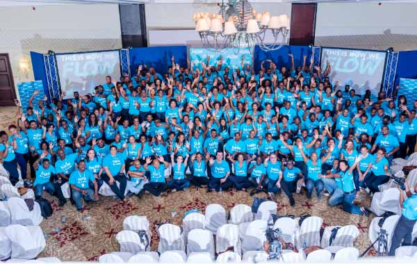 Image: The FLOW team in St. Lucia comes together for a massive celebration of the launch.