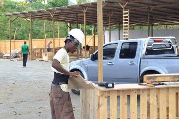 Image: Workmen getting The Arts Village ready.