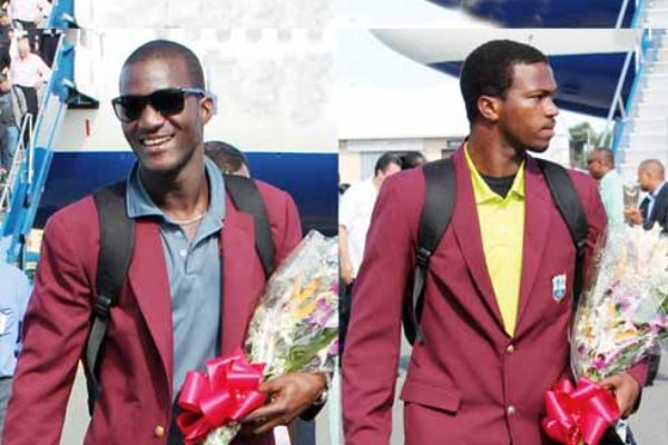 (L-R) World champions Darren Sammy and Johnson Charles. [PHOTO: Anthony De Beauville]