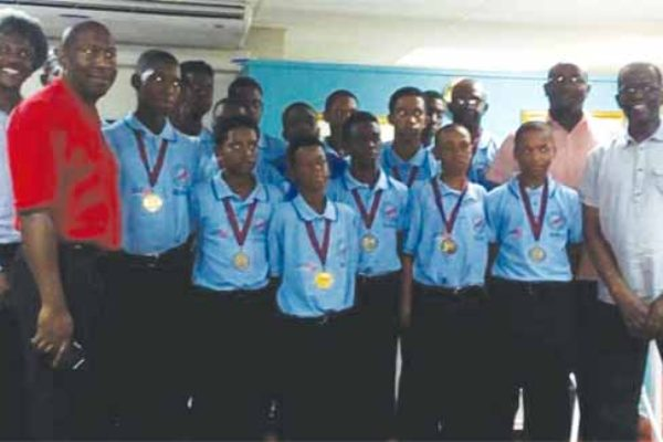 Image: A proud moment for the 2016 Windwards Under-15 Champion Cricket Team along with government officials on Sunday. (PHOTO: AC