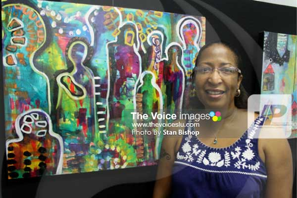 "Image: Artist Nicole Edgecombe and her favourite painting, ""Dauphin Spirit"". [PHOTO: Stan Bishop]"