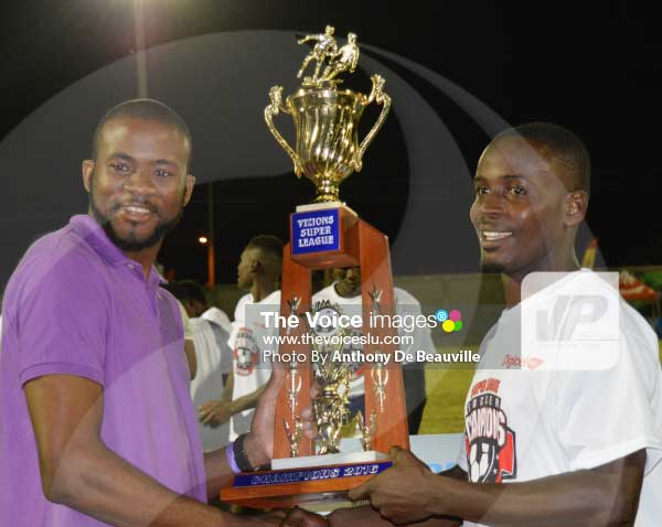Image: (L-R) Digicel Product Executive Dwayne Christophe presenting Micoud captain Travis Thomas with the champion's trophy. [PHOTO Anthony De Beauville]