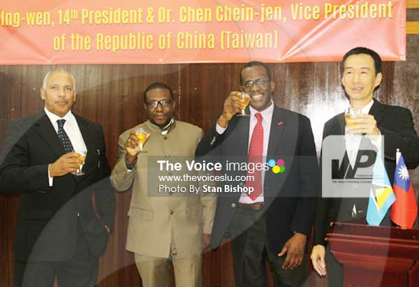 Image: House Speaker Peter Foster, External Affairs Minister Alva Baptiste, Deputy Prime Minister Phillip J. Pierre and Taiwanese Ambassador Ray Mou make a toast. [PHOTO: Stan Bishop]