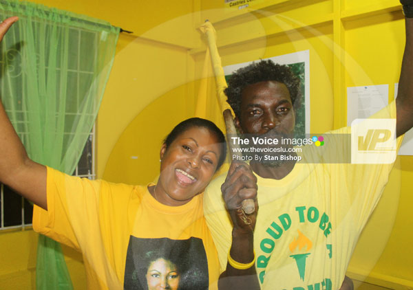 UWP's Sarah Flood-Beaubrun and a supporter celebrate in Castries Central