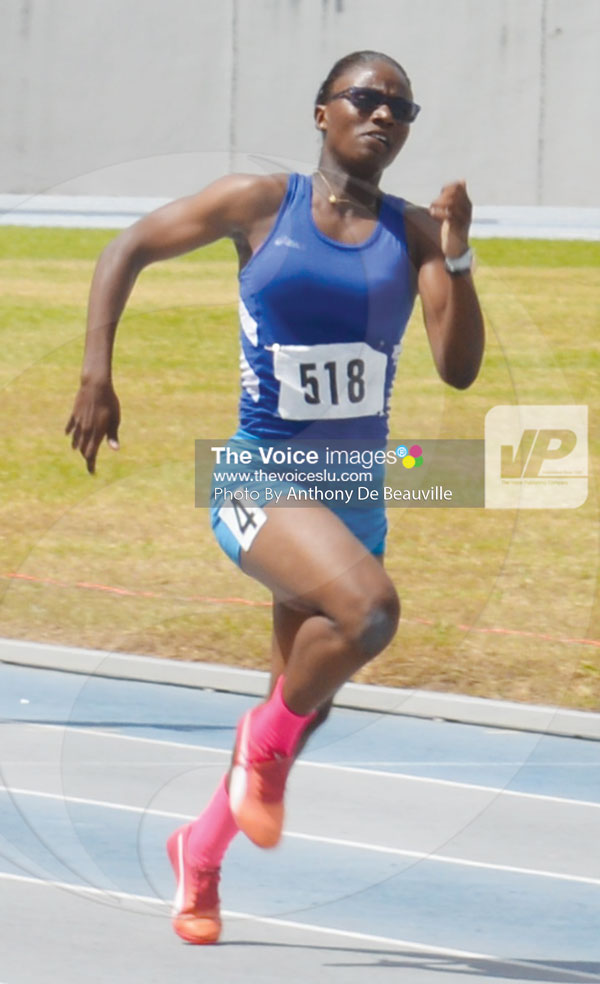img: ulian Alfred on her wat to win the women's 100 metres