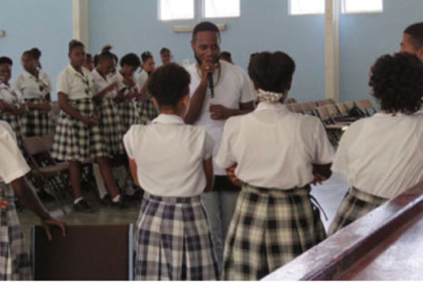 img:Sedale sharing his knowledge of the arts with schoolchildren.