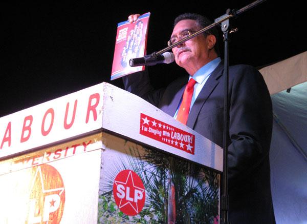 Prime Minister Anthony holding up manifesto. [PHOTO: Photo Mike]